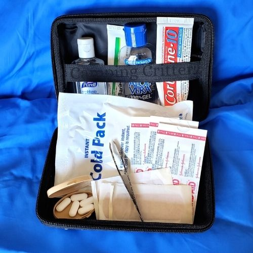 Basic car camping first aid kit. Cold pack, tweezers, anti-itch cream, medicine, bandages, aloe and hand sanitizer.