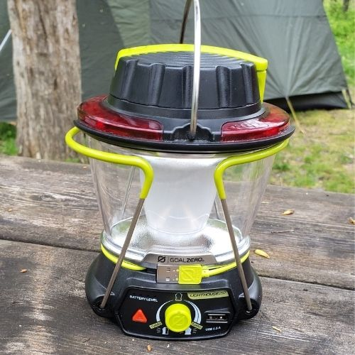 Camping lantern with USB charging cable, crank charger, red flasher, handle and extendable legs