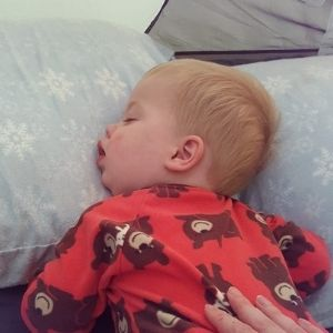 Infant sleeping on pillow in tent