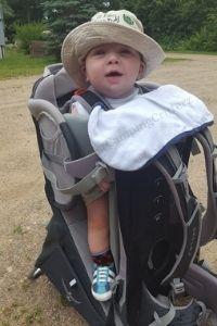 Child in an Osprey Poco Plus child carrier