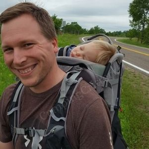Toddler sleeping in Osprey Poco child carrier backpack