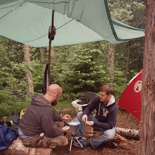 Playing cards under a tarp while it's raining