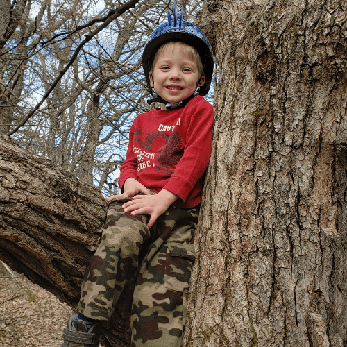 taking a break on our hike to climb a tree
